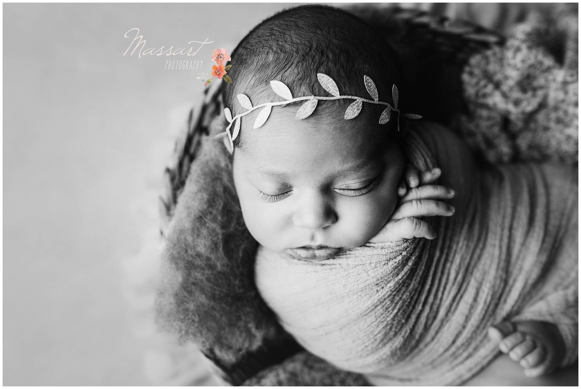 Newborn baby girl sleeps in a basket wrapped in a blanket photographed by Massart Photography Rhode Island