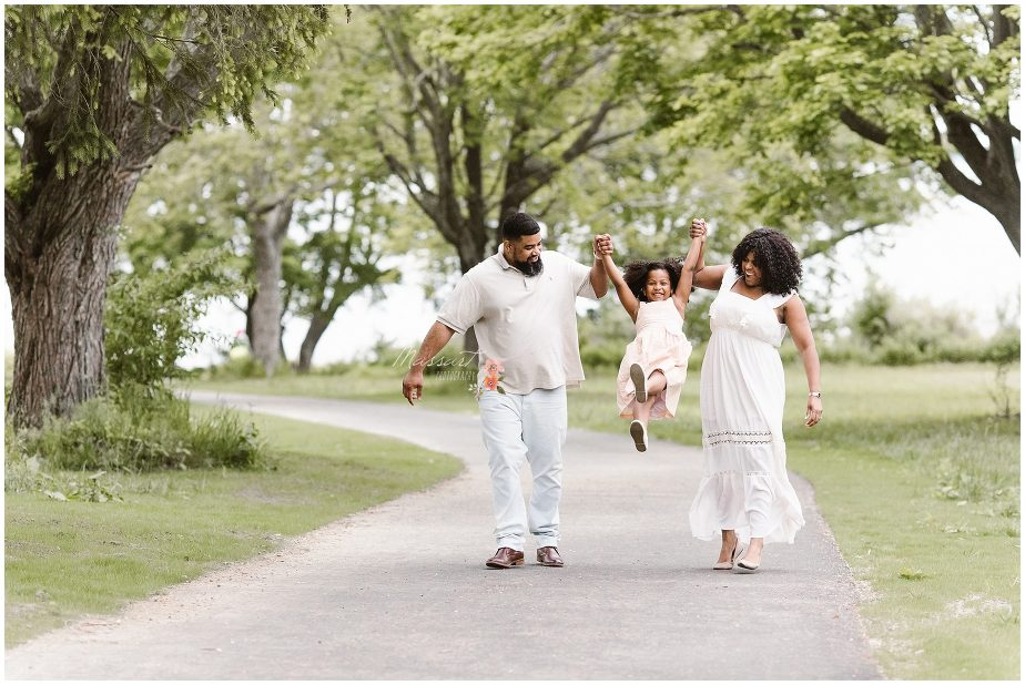 Playful outdoor portraits of the family during their session photographed by Massart Photography Rhode Island