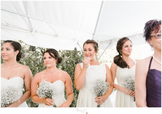 An emotional bridesmaid sees the bride walking down the aisle at her kirkbrae country club wedding ceremony in rhode island