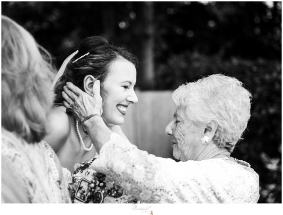 bride and grandmother share a moment after a wedding ceremony in rhode island at kirkbrae country club Massart photography