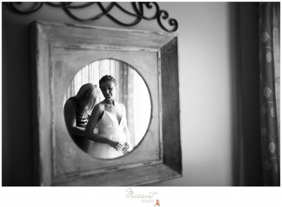 Mother helps the bride get dressed before the Newport Beach House wedding photographed by Massart Photography Rhode Island