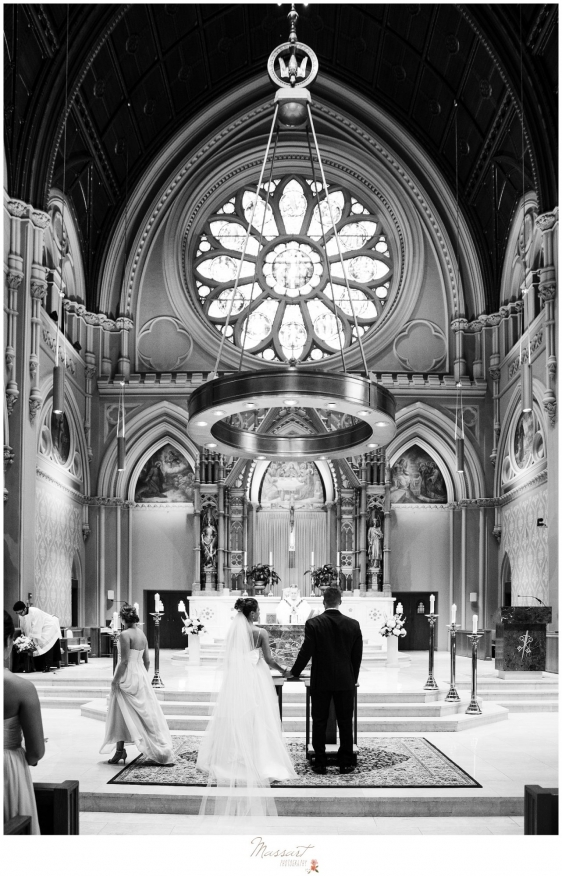 Bride and groom say their vows during the Newport RI wedding photographed by Massart Photography RI