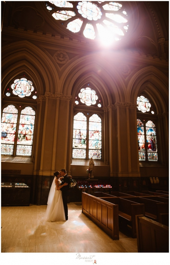 Photos of the bride and groom in the church after getting married in Newport RI photographed by Massart Photography RI
