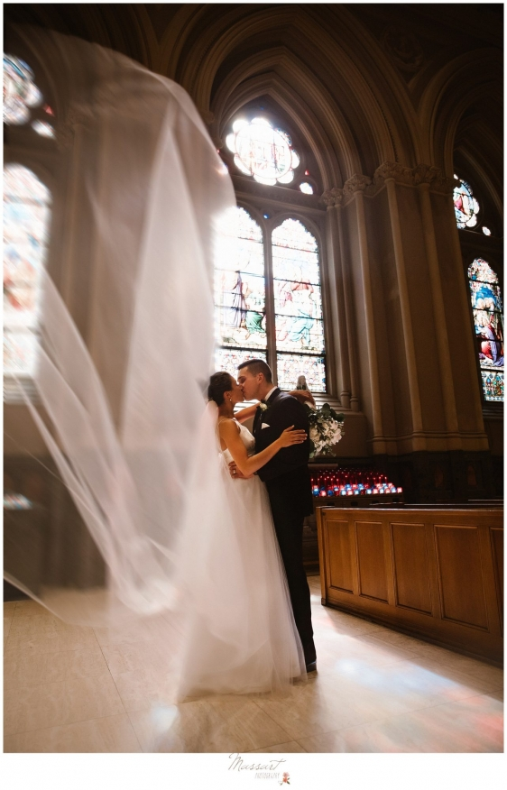 Bride and groom in the church after getting married in Newport RI photographed by Massart Photographyv RI