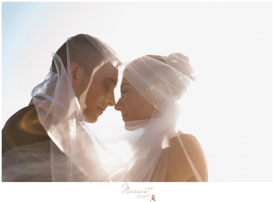 Photo of bride and groom through the veil on the beach in Newport RI photographed by Massart Photography Rhode Island
