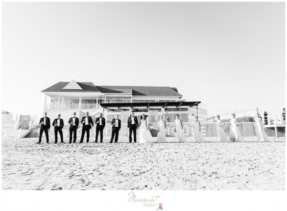 Bride and groom with the wedding party on the beach at the Newport Beach House RI photographed by Massart Photography RI