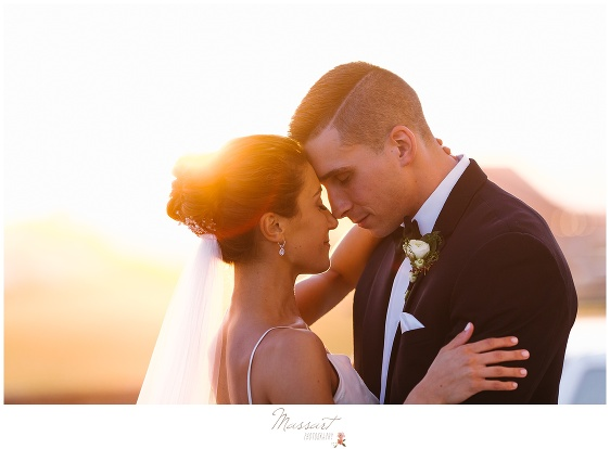 Bride and groom during the sunset at the Newport Beach House summer wedding photographed by Massart Photography Rhode Island
