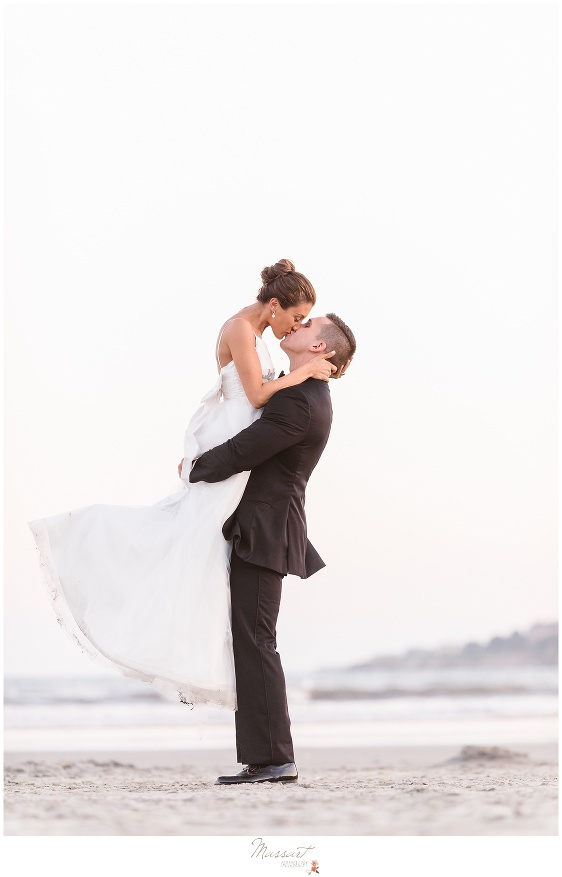 Bride and groom share a kiss on Newport RI beach photographed by Massart Photography Rhode Island