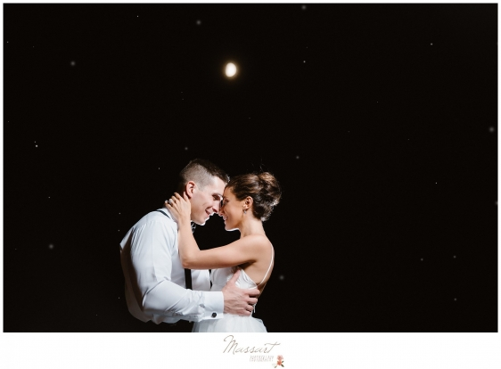 Bride and groom take pictures underneath the moon during their Newport RI summer wedding photographed by Massart Photography RI