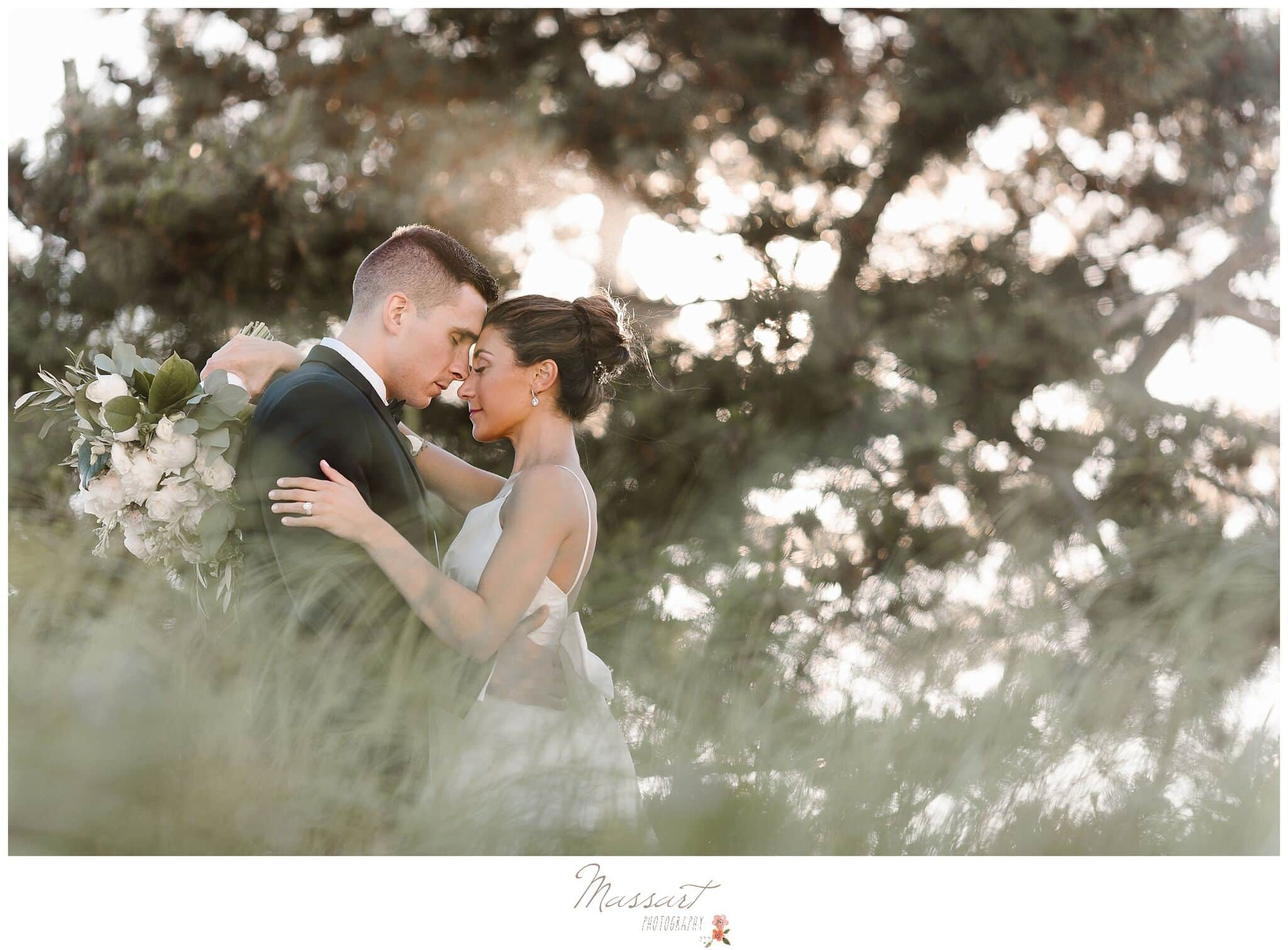 Outdoor wedding photo of bride and groom in a field photographed by Massart Photography RI