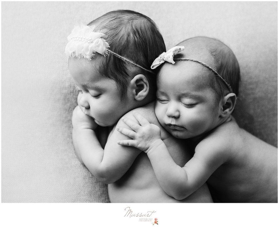 Newborn baby girls sleep together photographed by Massart Photography Rhode Island