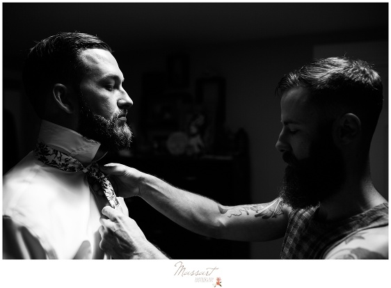 Groomsmen help the groom get ready for his Newport, RI wedding photographed by Massart Photography Rhode Island