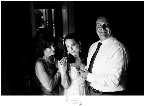 The bride poses with her mother and father before her Newport RI wedding photographed by Massart Photography Rhode Island