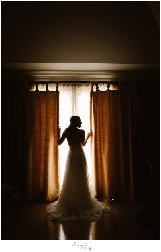 Silhouette portrait of the bride in her wedding gown just before her Newport, Rhode Island wedding photographed by Massart Photography RI