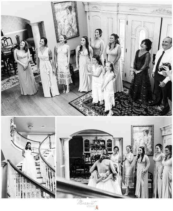 The bride makes her first appearance in her wedding gown to her bridal party and her parents before the wedding ceremony in Newport RI photographed by Massart Photography Rhode Island