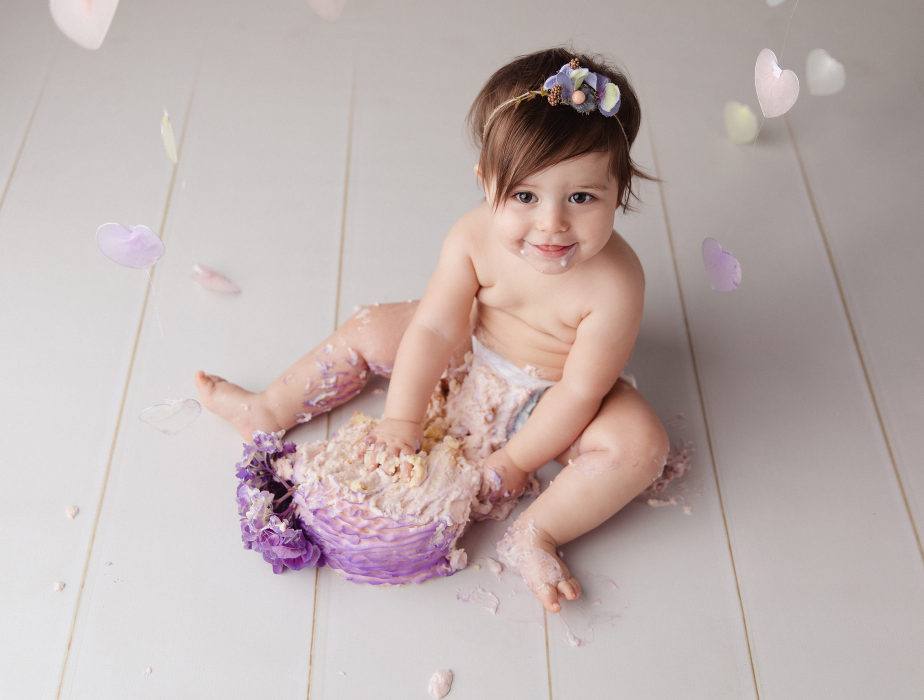 One year old smashes first birthday cake photographed by Massart Photography Rhode Island