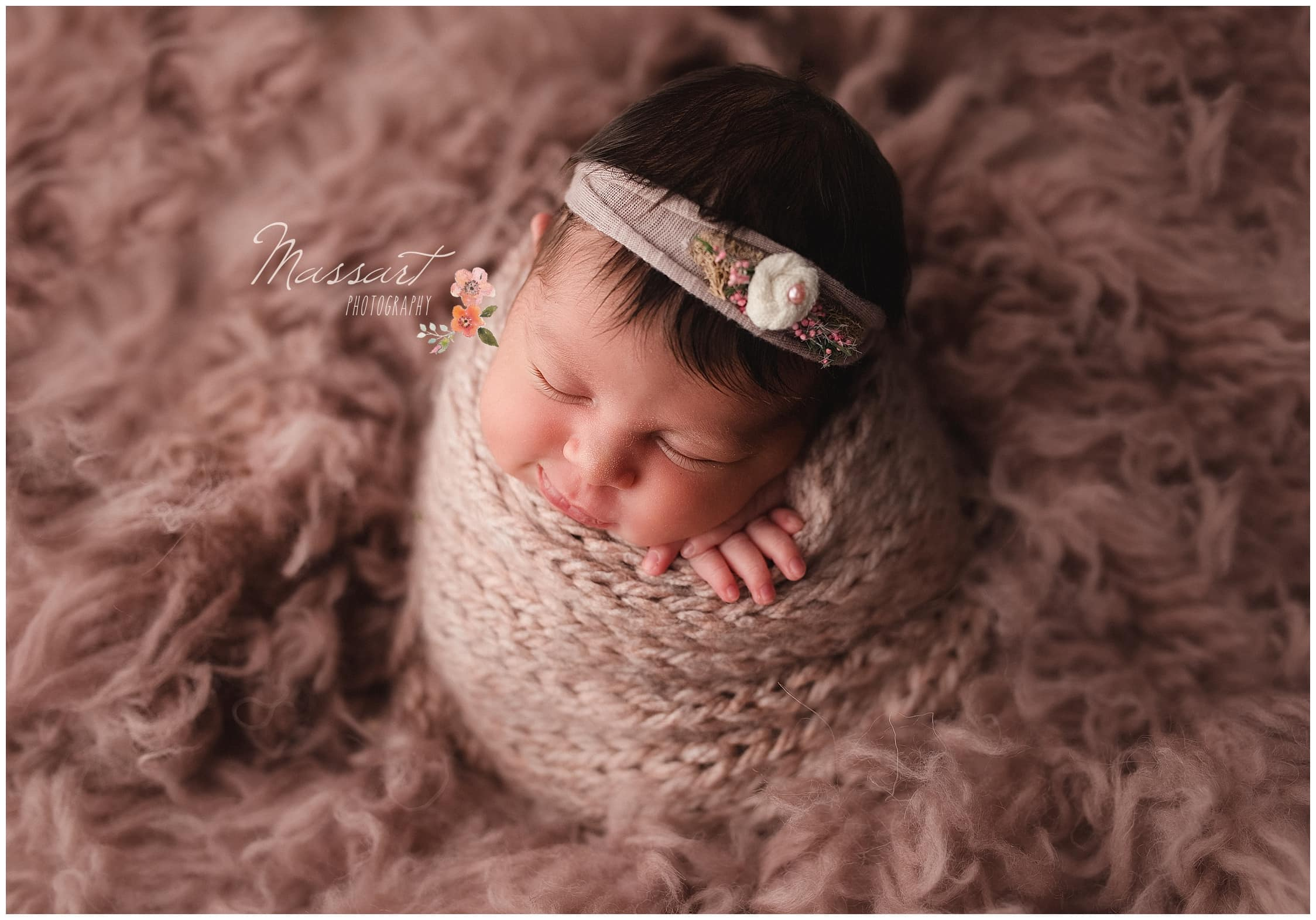 Baby girl wrapped in knit blanket during her newborn portrait shoot photographed by Massart Photography Rhode Island