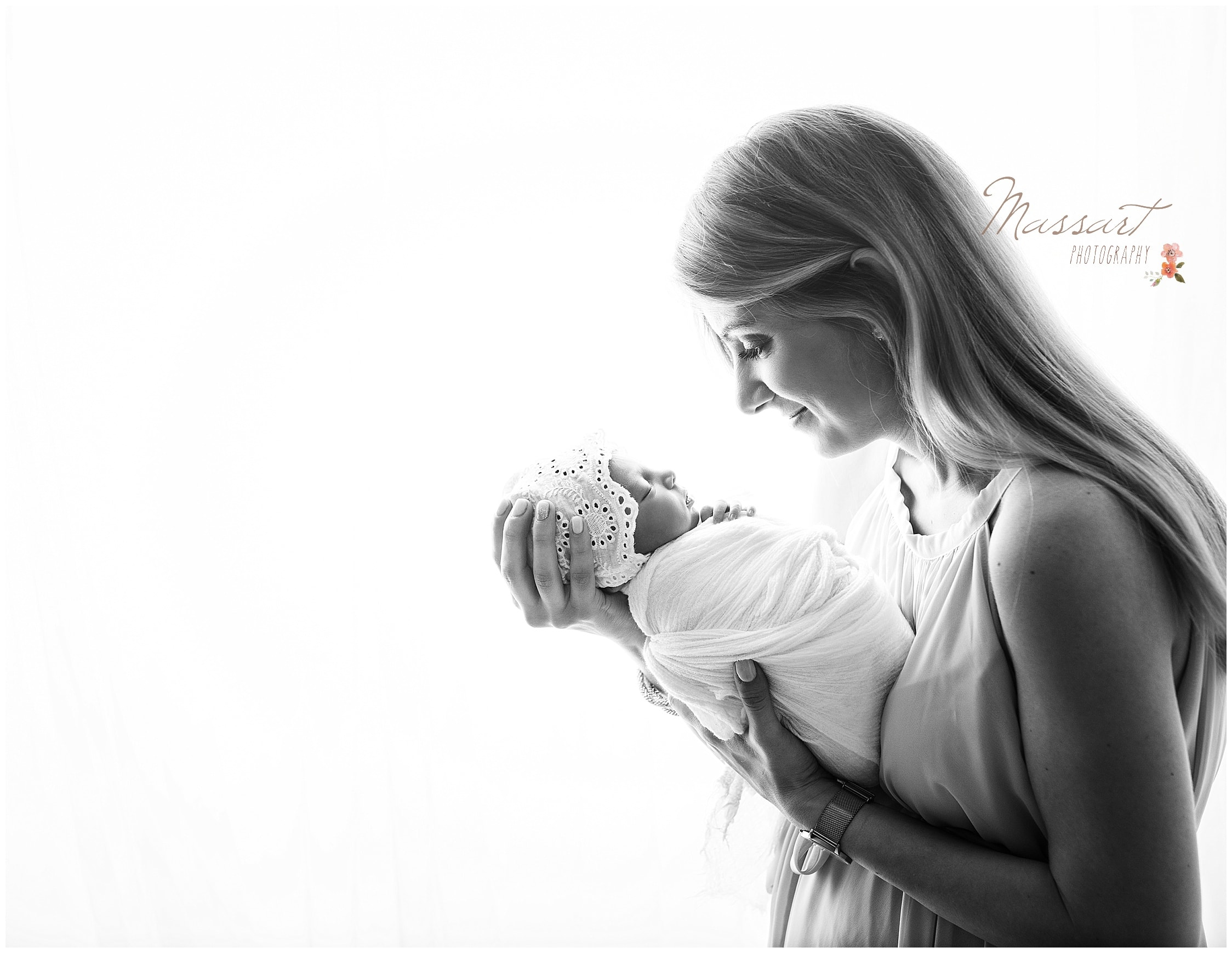 Mother holds her newborn baby girl photographed by Massart Photography RI