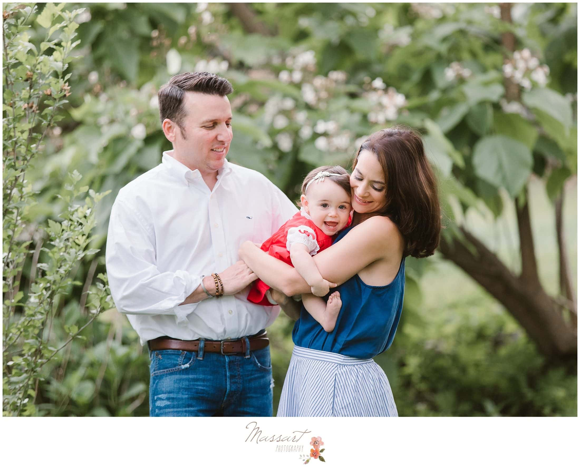 family portrait in the blueberry farm during daughter's first birthday cake smash session photographed by Massart Photography RI