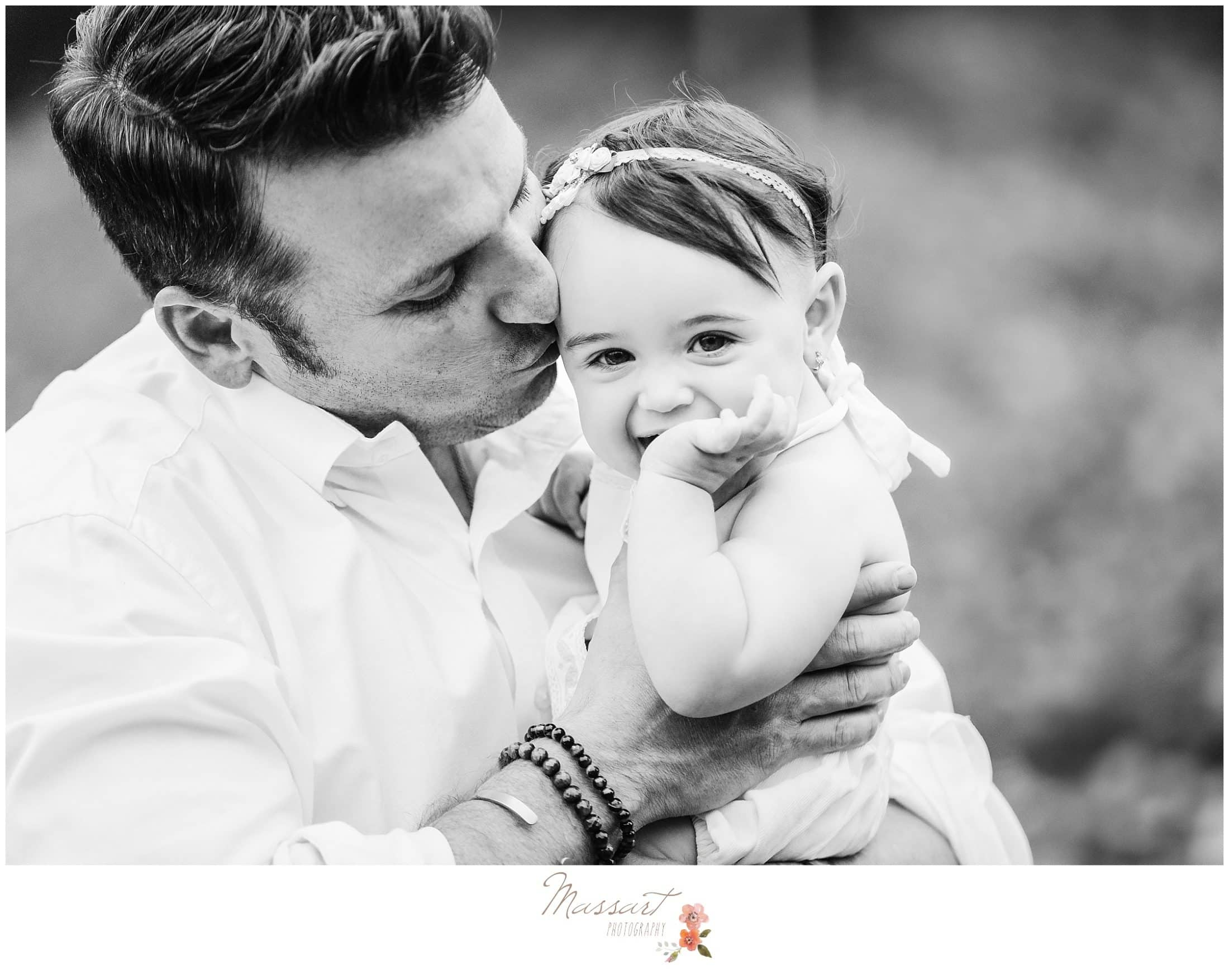 Black and white image of father and daughter during milestone portrait session photographed by Massart Photography RI