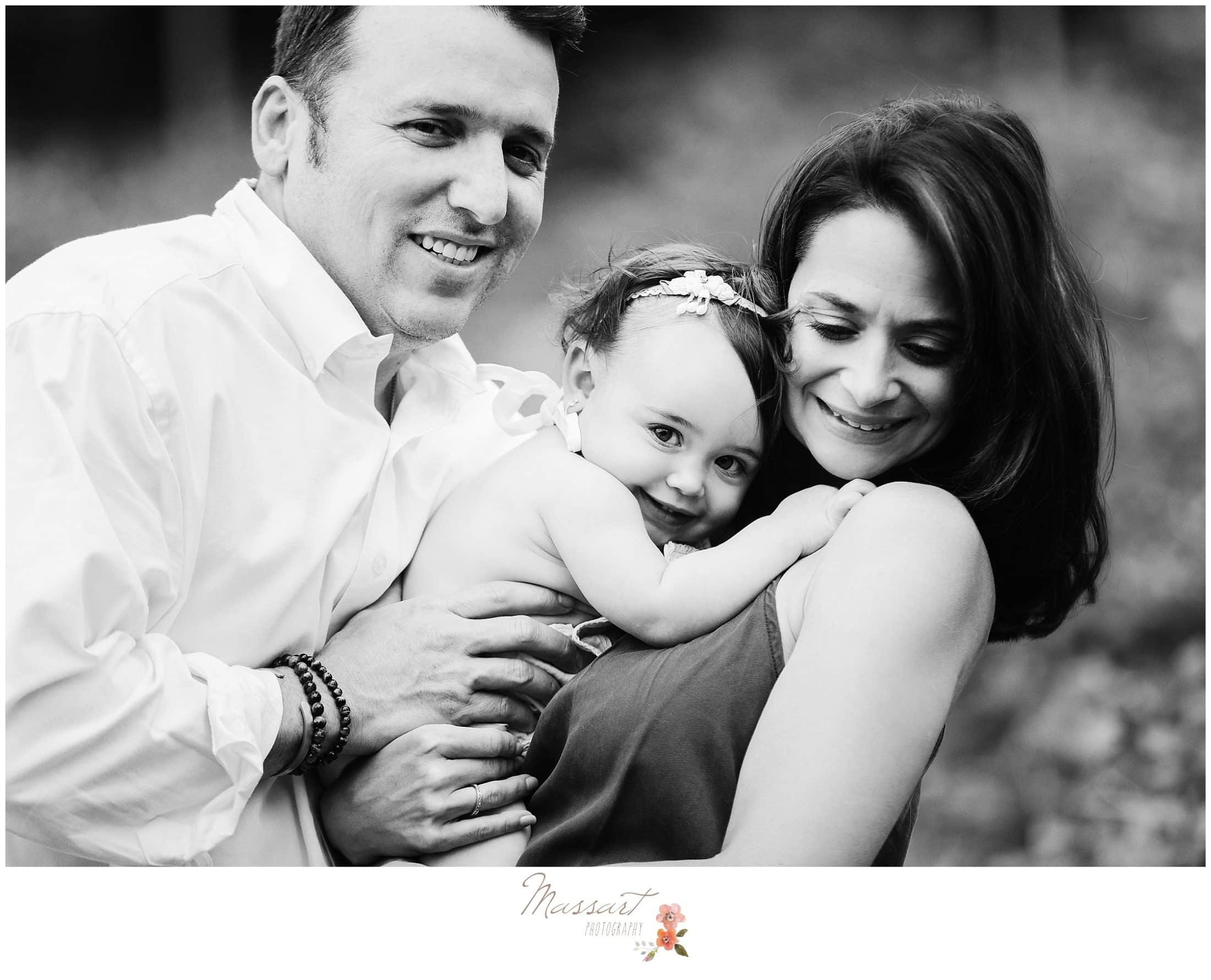 Black and white image of family during baby girl's one year milestone session photographed by Massart Photography Rhode Island