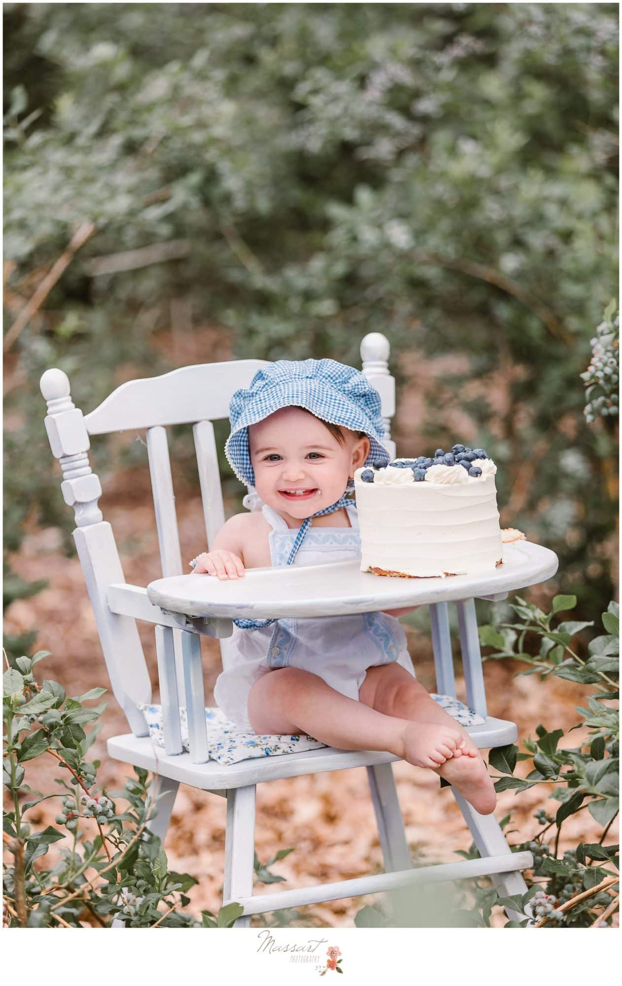 Baby smiles during her blueberry farm cake smash session photographed by Massart Photography Rhode Island