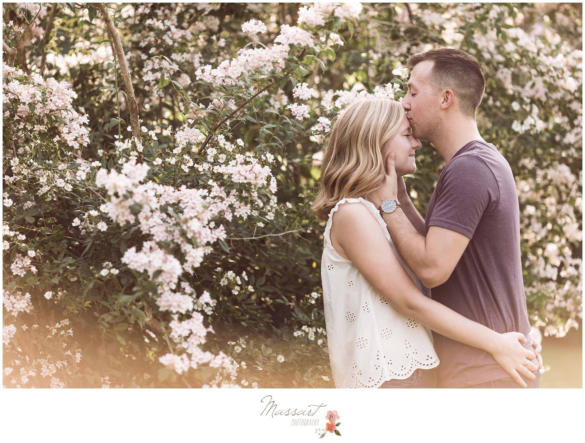 Fiance kisses his soon-to-be wife during engagement session photographed by Massart Photography RI