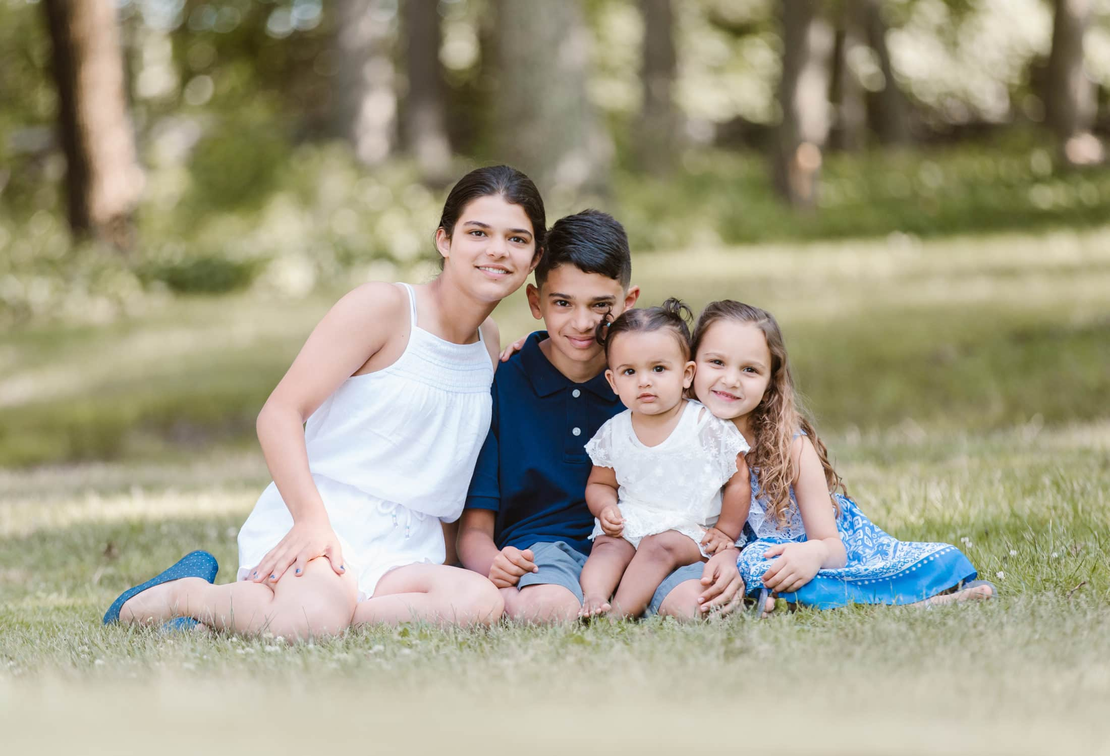 Family poses outside at the park during the Public Safety event photographed by Massart Photography RI