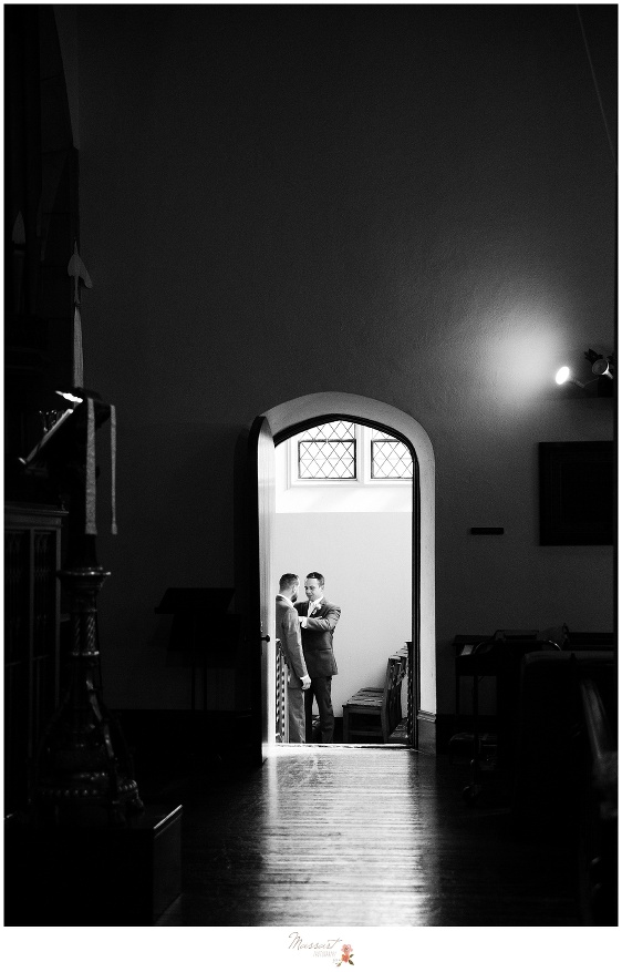 Groom and best man photographed moments before the ceremony at st. emmanuel church in newport, RI