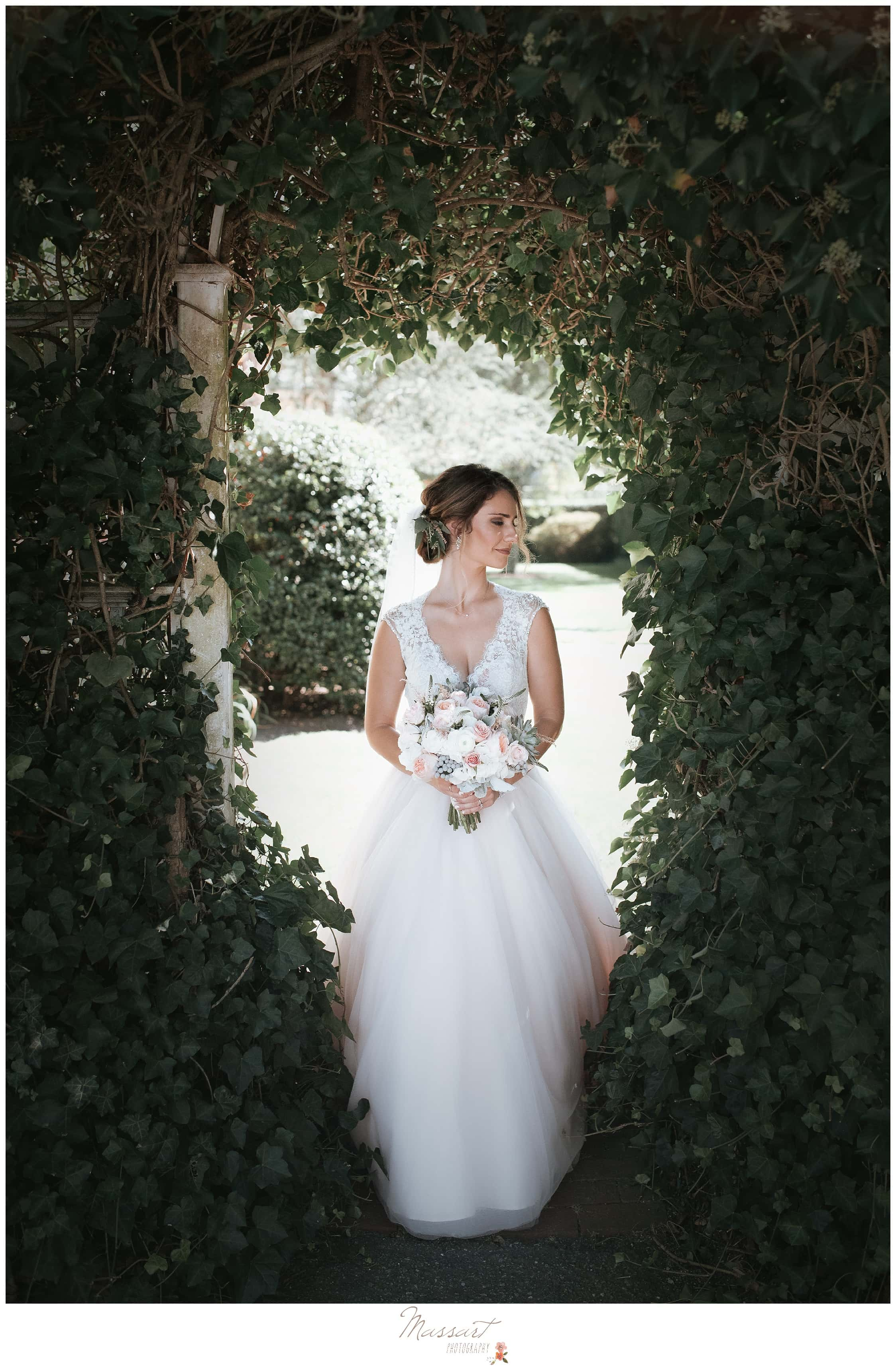Massart Photography uses the beautiful gardens of The Ivy lodge in newport, RI for a portrait of the bride
