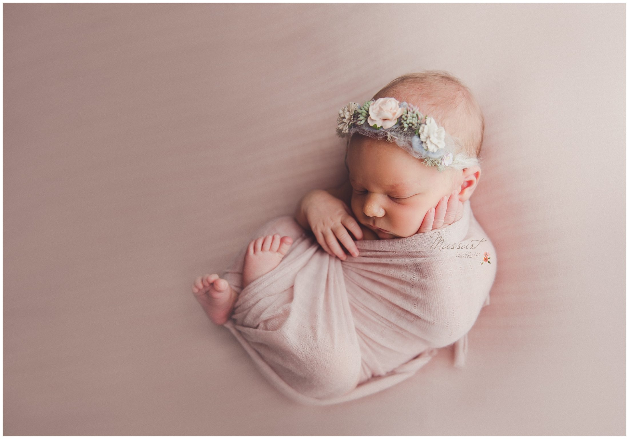 Baby girl wrapped in pink blanket with flower crown photographed by Massart Photography Rhode Island