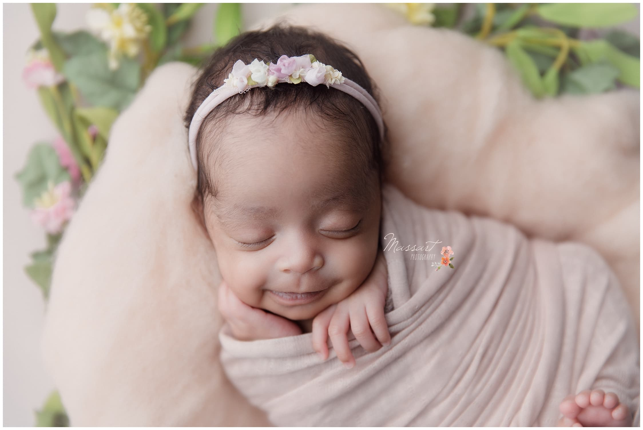 Baby smiles during her newborn portrait session photographed by Massart Photography RI