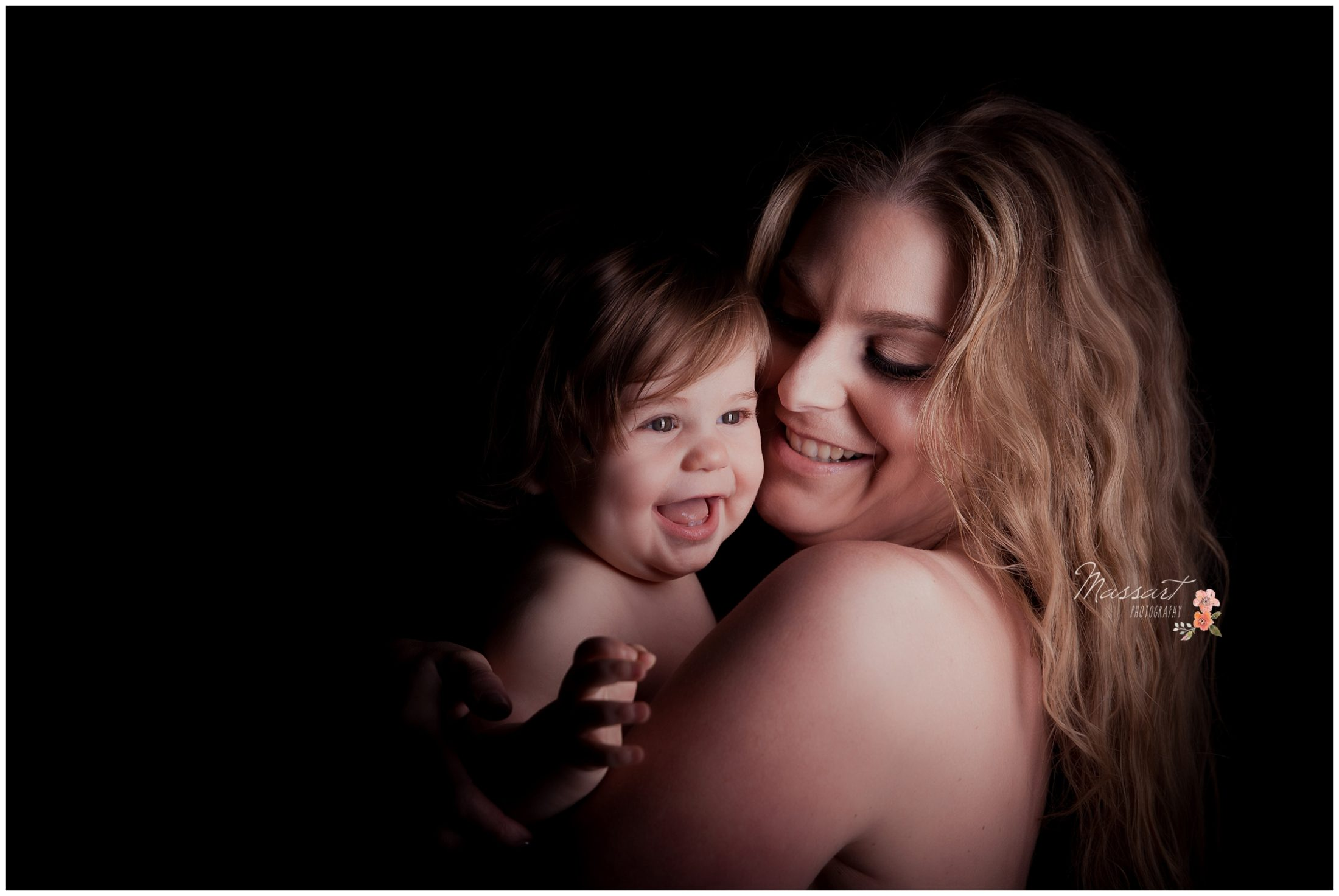 Spotlight portrait with mom and her baby during milestone session photographed by Massart Photography Rhode Island