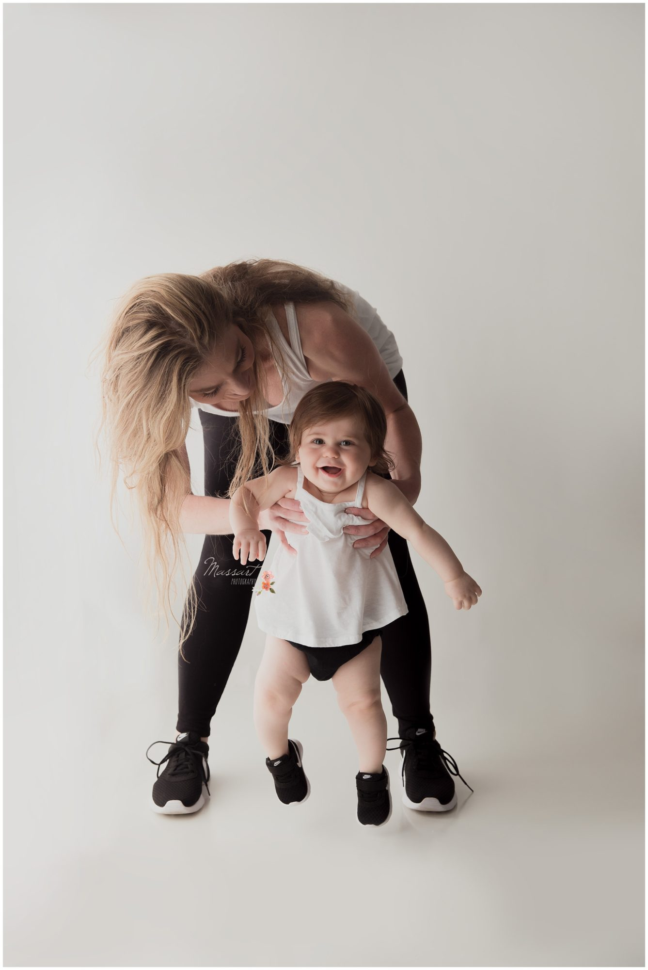 Mom and baby girl wear matching Nike's during baby's milestone session photographed by Massart Photography Rhode Island