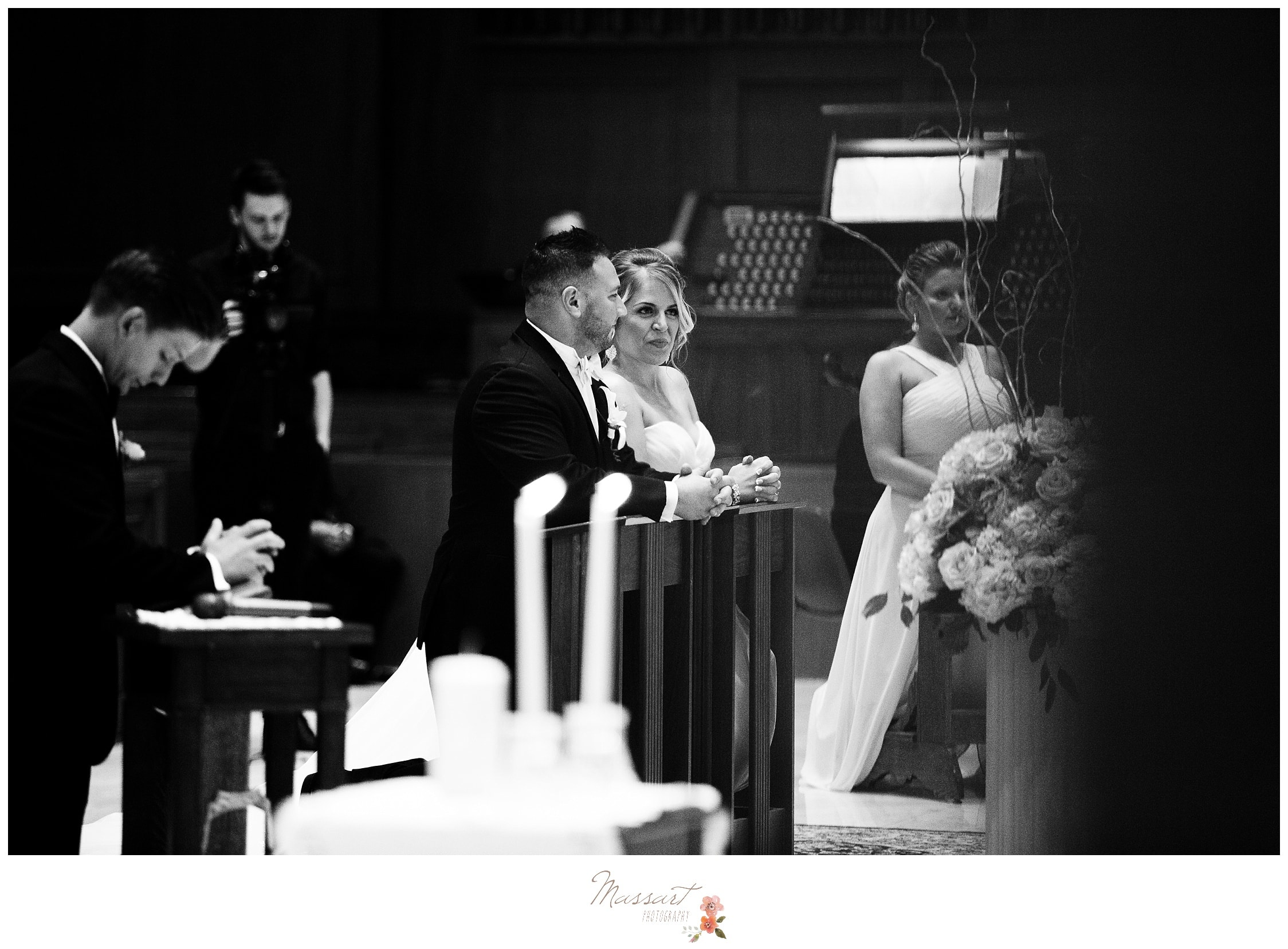 Bride and groom complete their wedding rituals during their ceremony photographed by Massart Photography Rhode Island