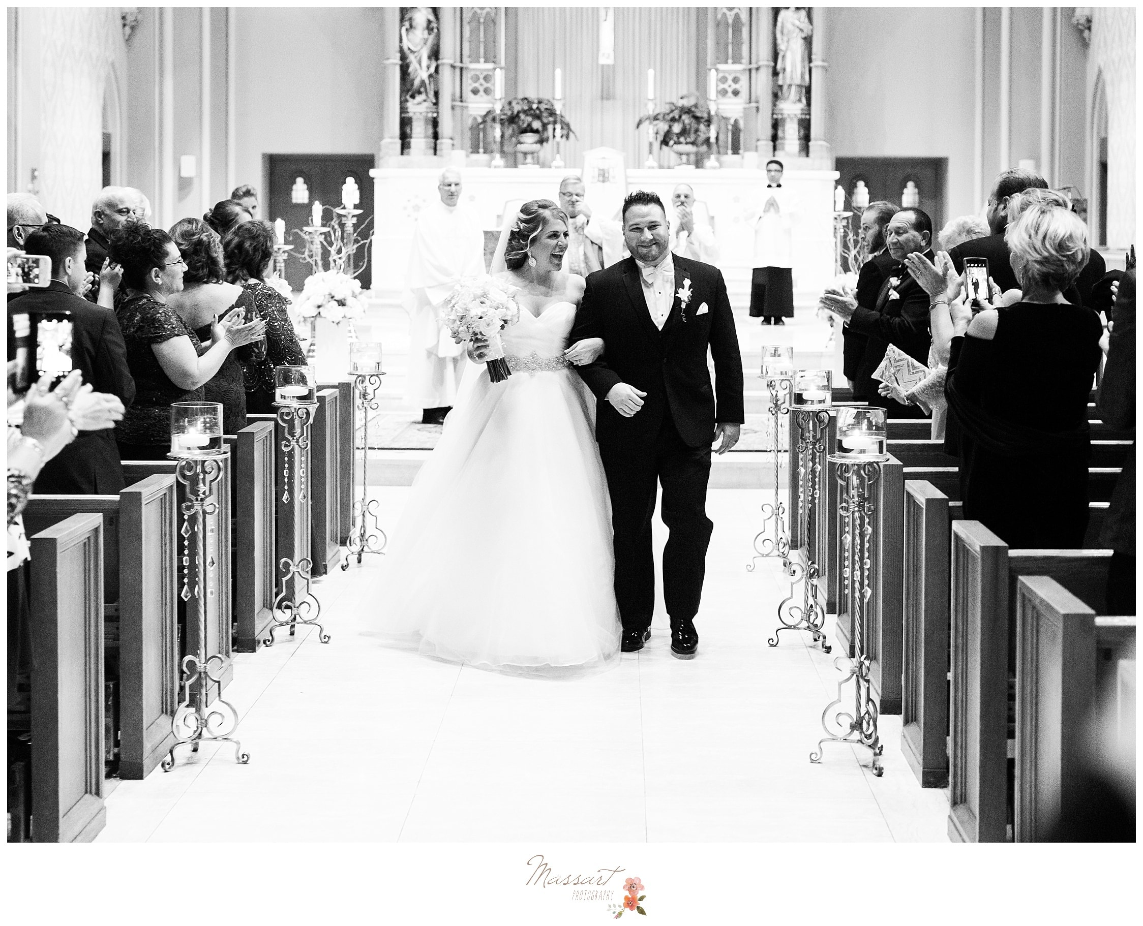 Husband and wife walk down the aisle during the wedding ceremony photographed by Massart Photography RI