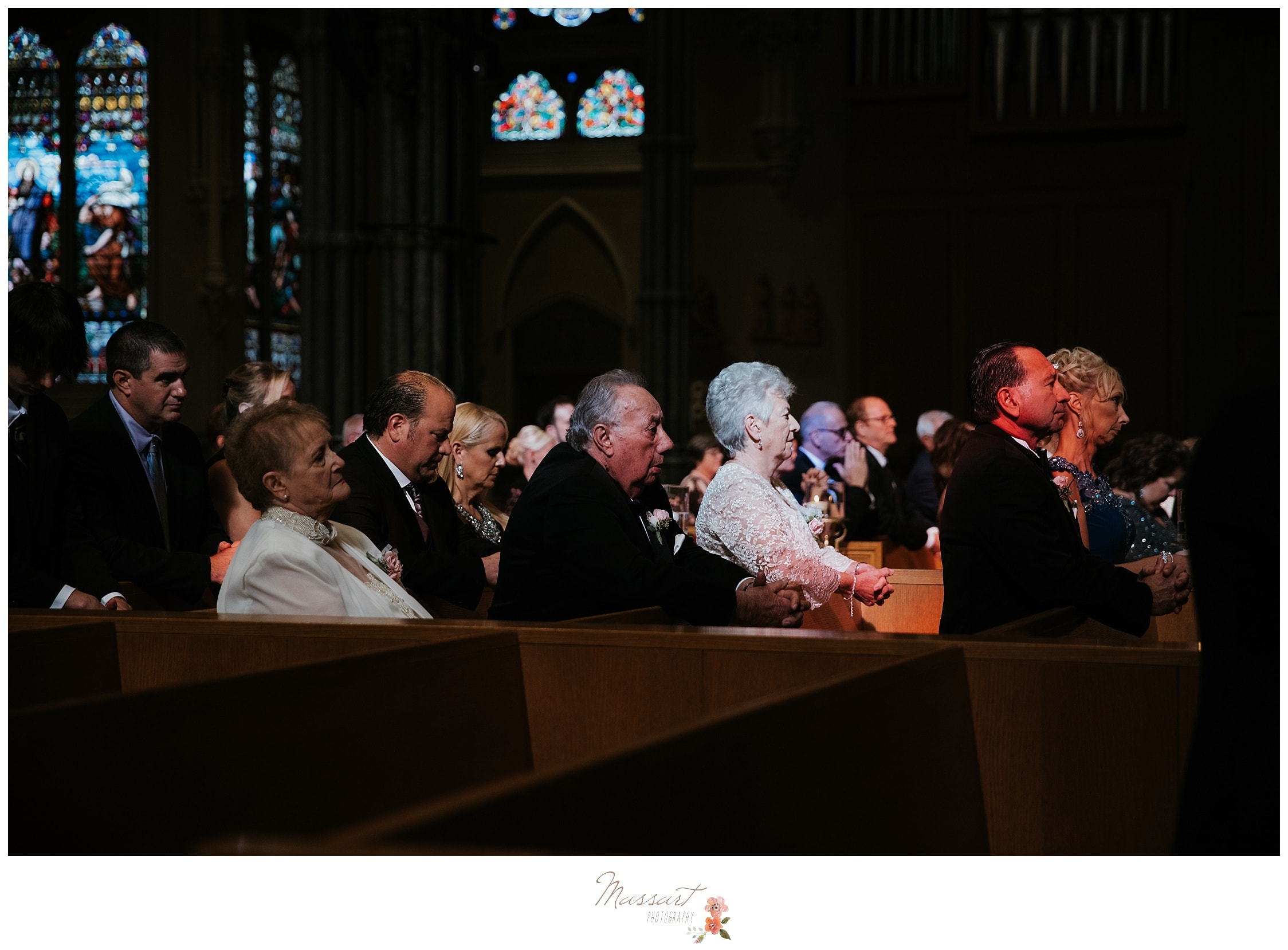Wedding guests at the wedding ceremony photographed by Massart Photography RI