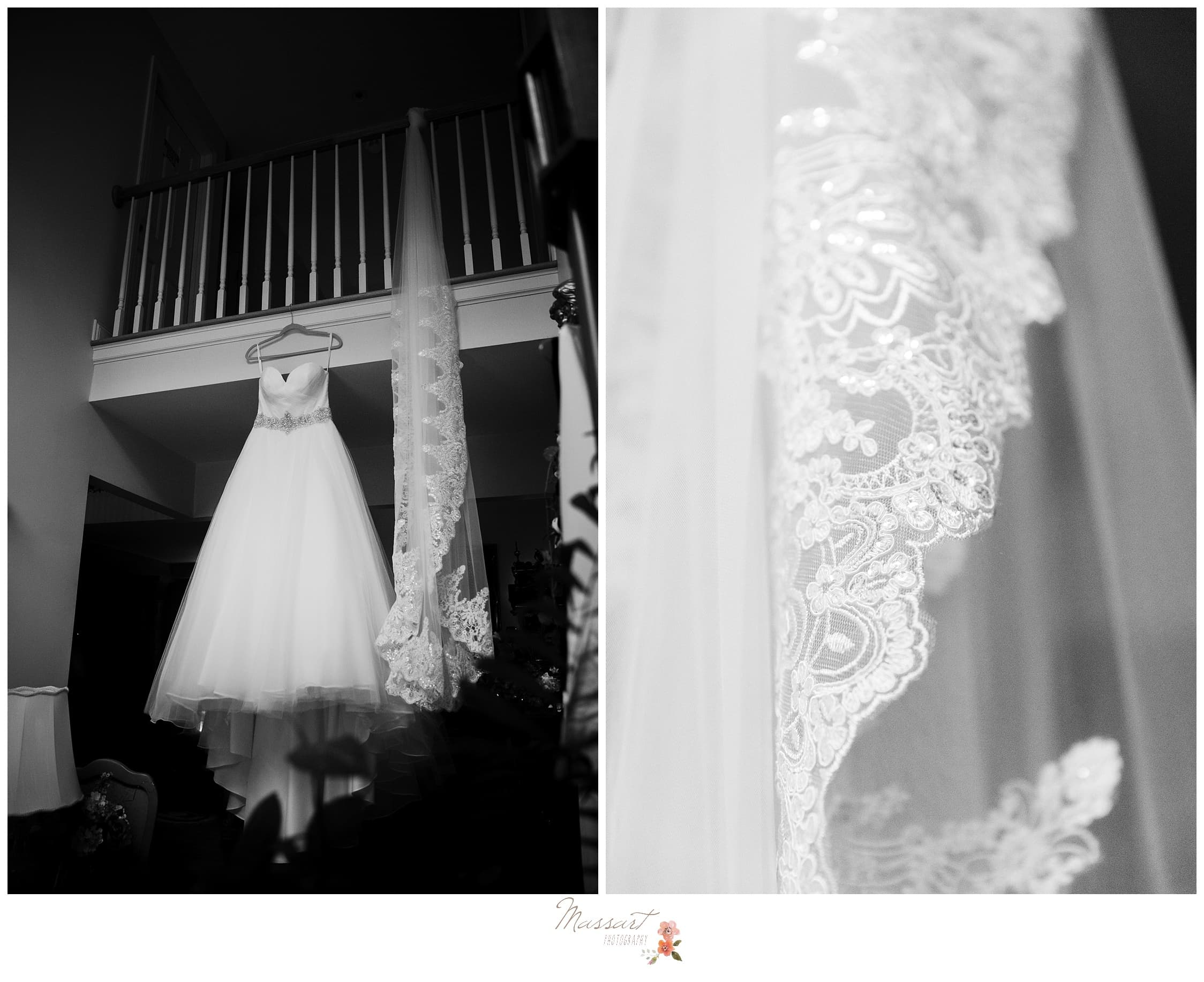 Bride's wedding gown hangs up before the Providence, RI wedding ceremony photographed by Massart Photography Rhode Island