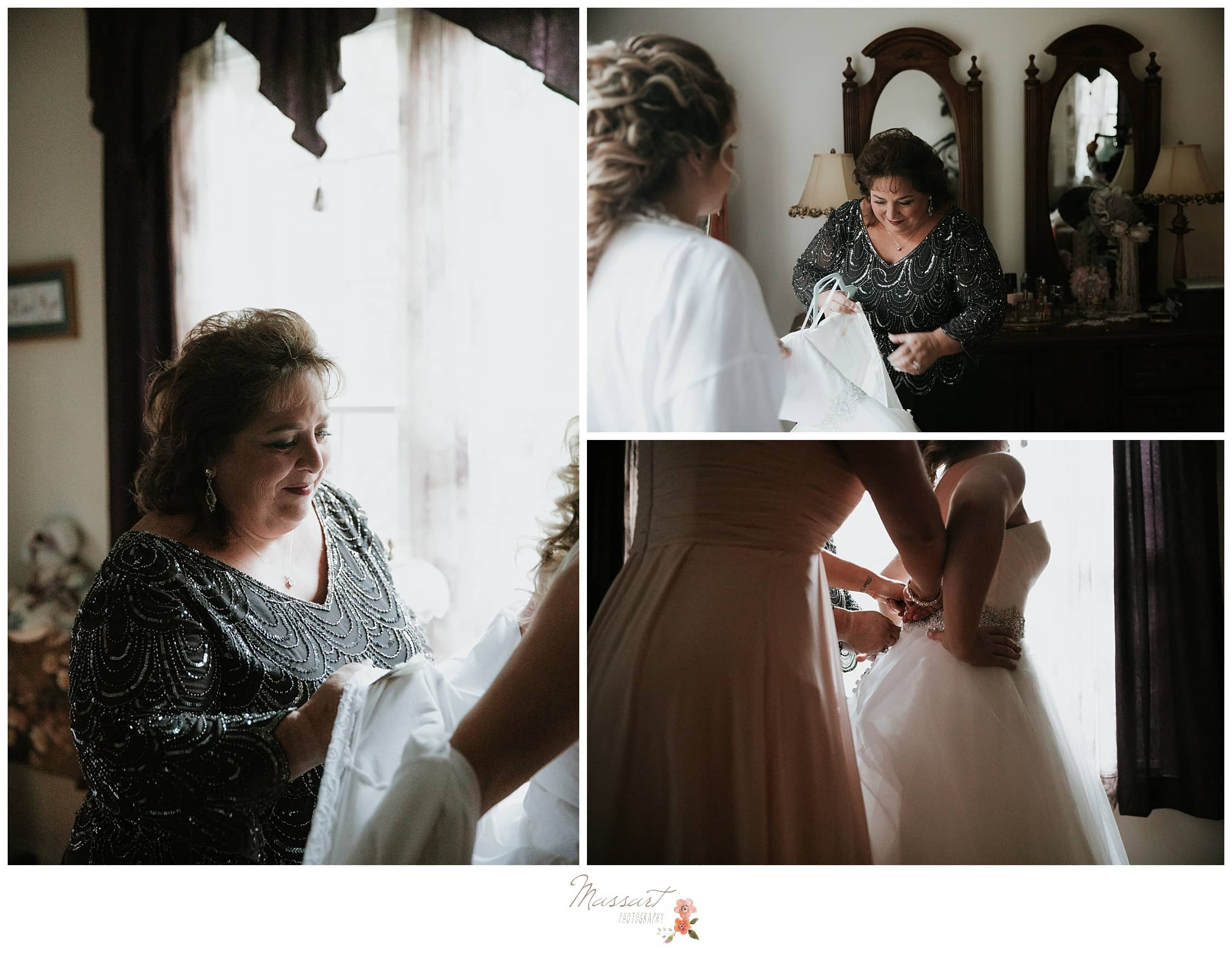 Bride's family helps her get into her wedding gown photographed by Massart Photography RI