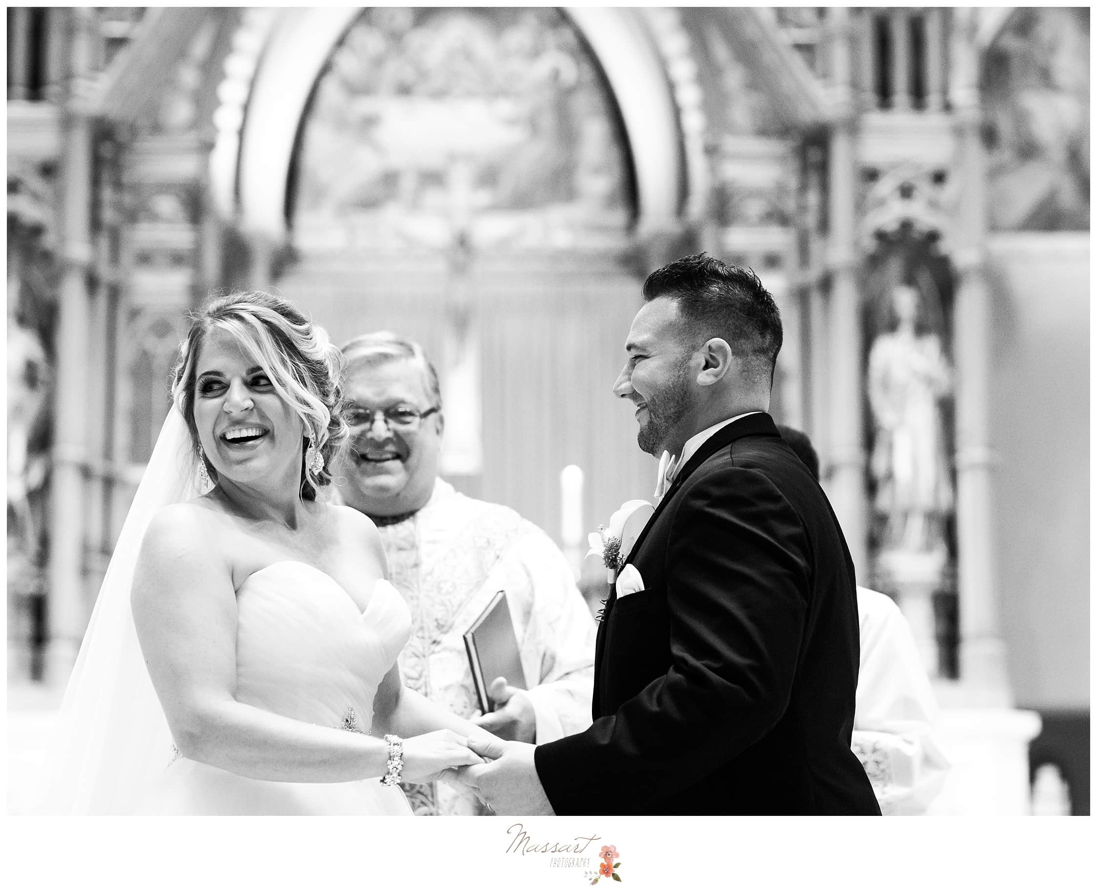 Black and white portrait of the bride and groom at the altar photographed by Massart Photography of Warwick RI