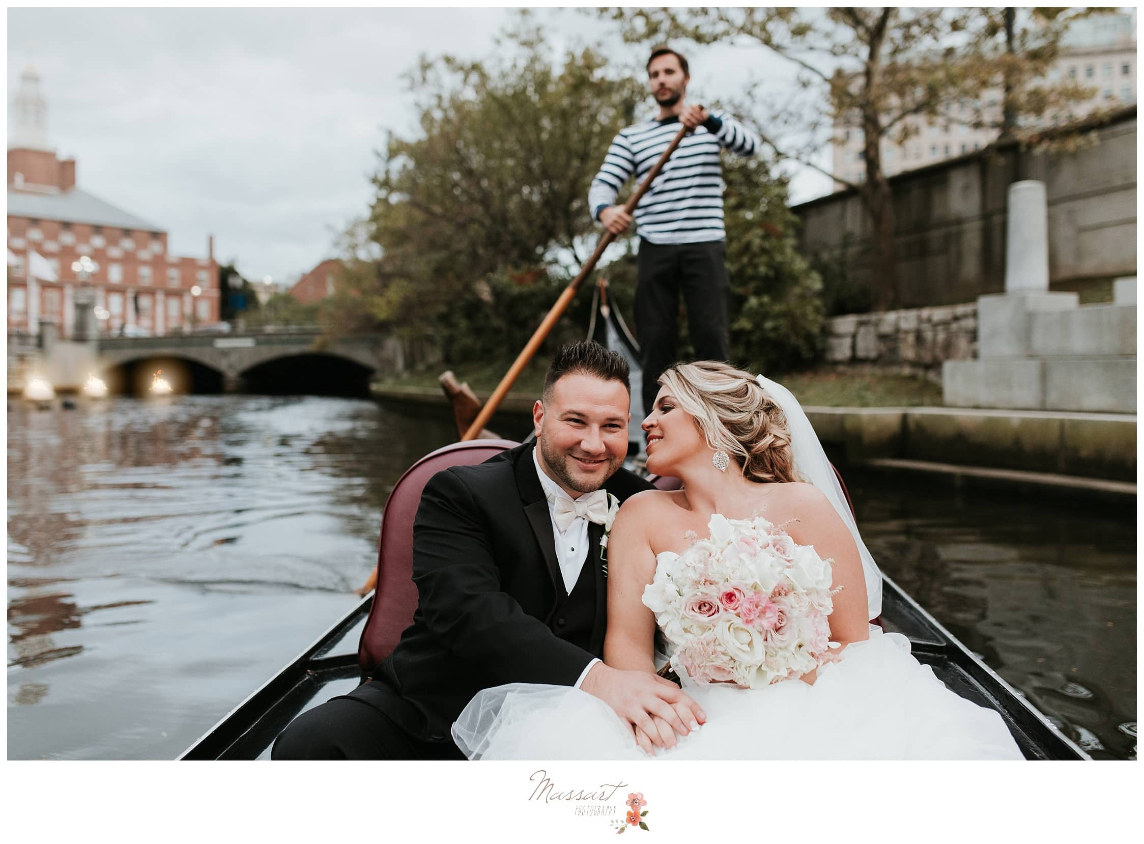 Newlyweds share a romantic gondola ride around Waterpark Place in Providence, Rhode Island photographed by Massart Photography RI