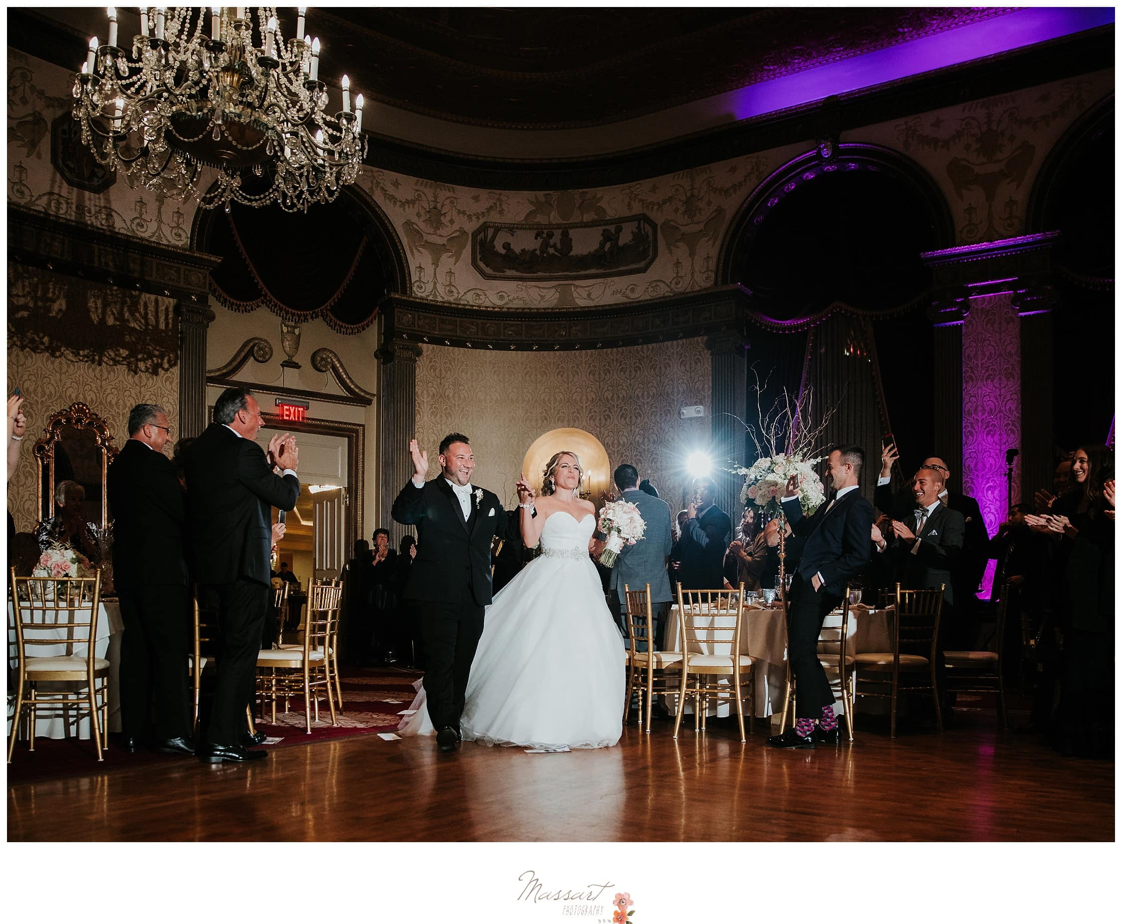 Bride and groom enter their reception photographed by Massart Photography RI
