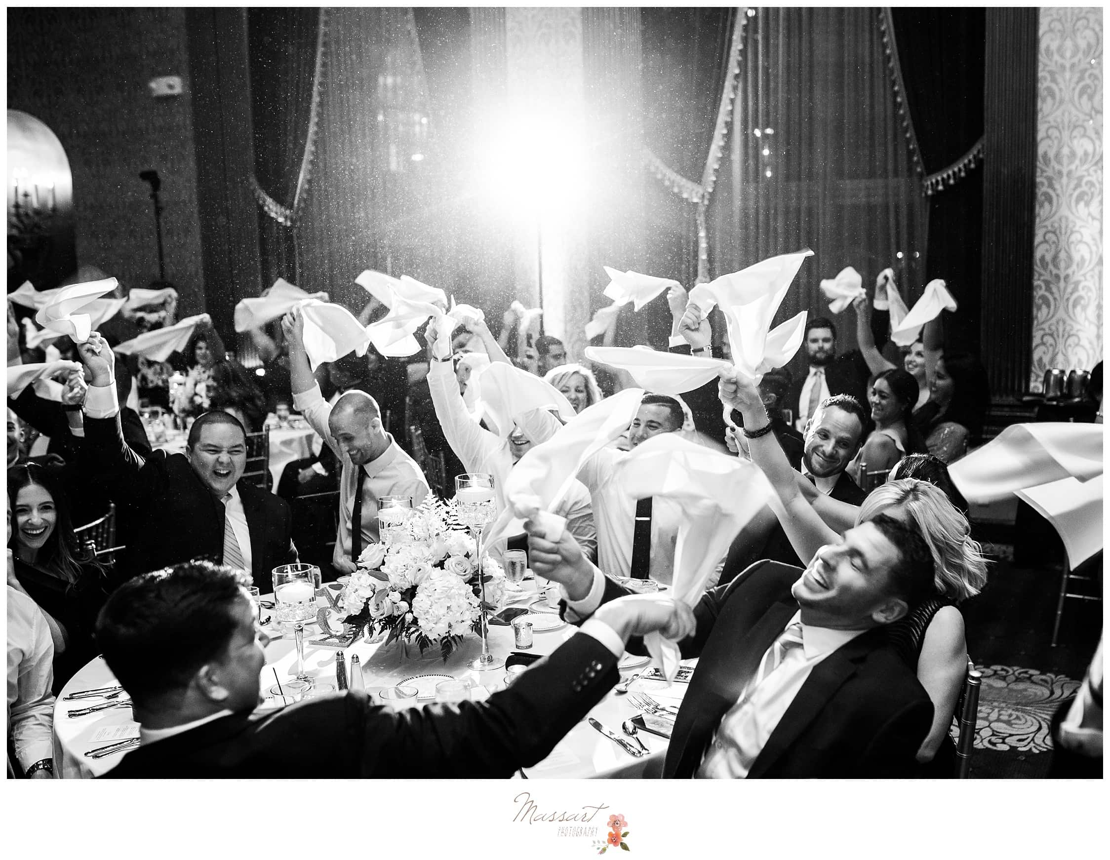 Guests spin their napkins as an Italian tradition photographed by Massart Photography RI