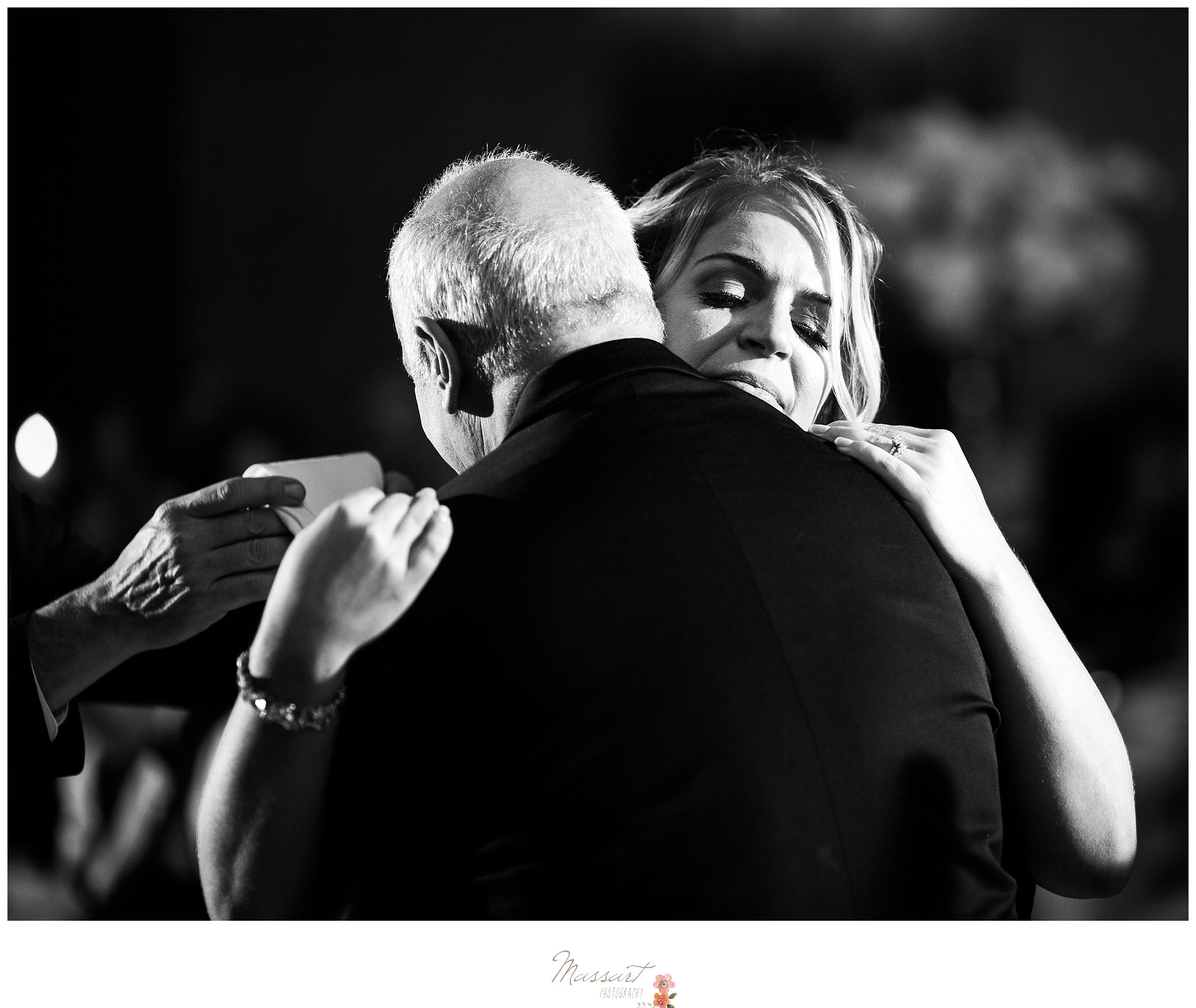 Black and white portrait of a special moment between the bride and her father at the wedding ceremony photographed by Massart Photography RI
