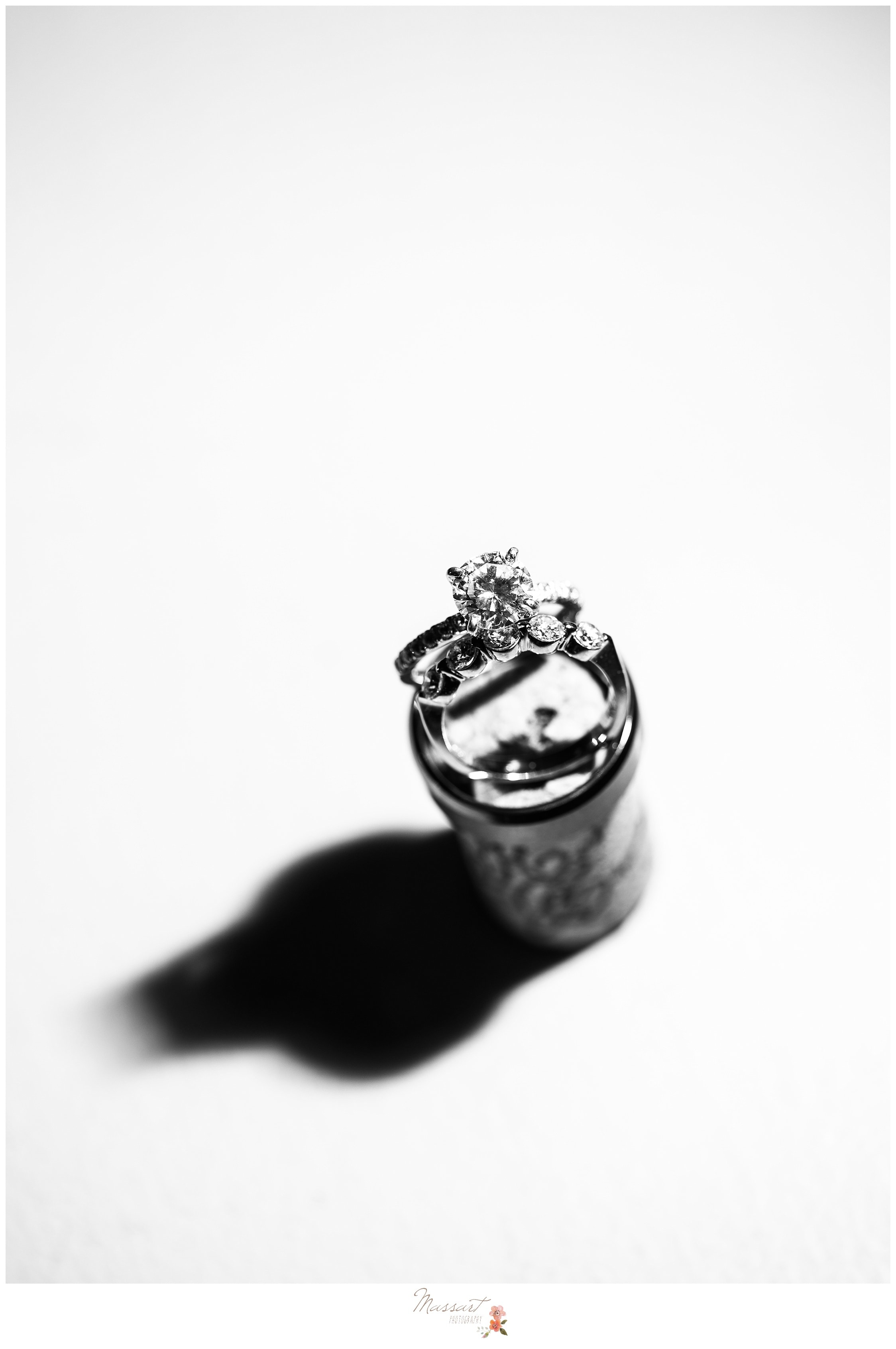 Black and white portrait of the bride and groom's wedding rings photographed by Massart Photography RI