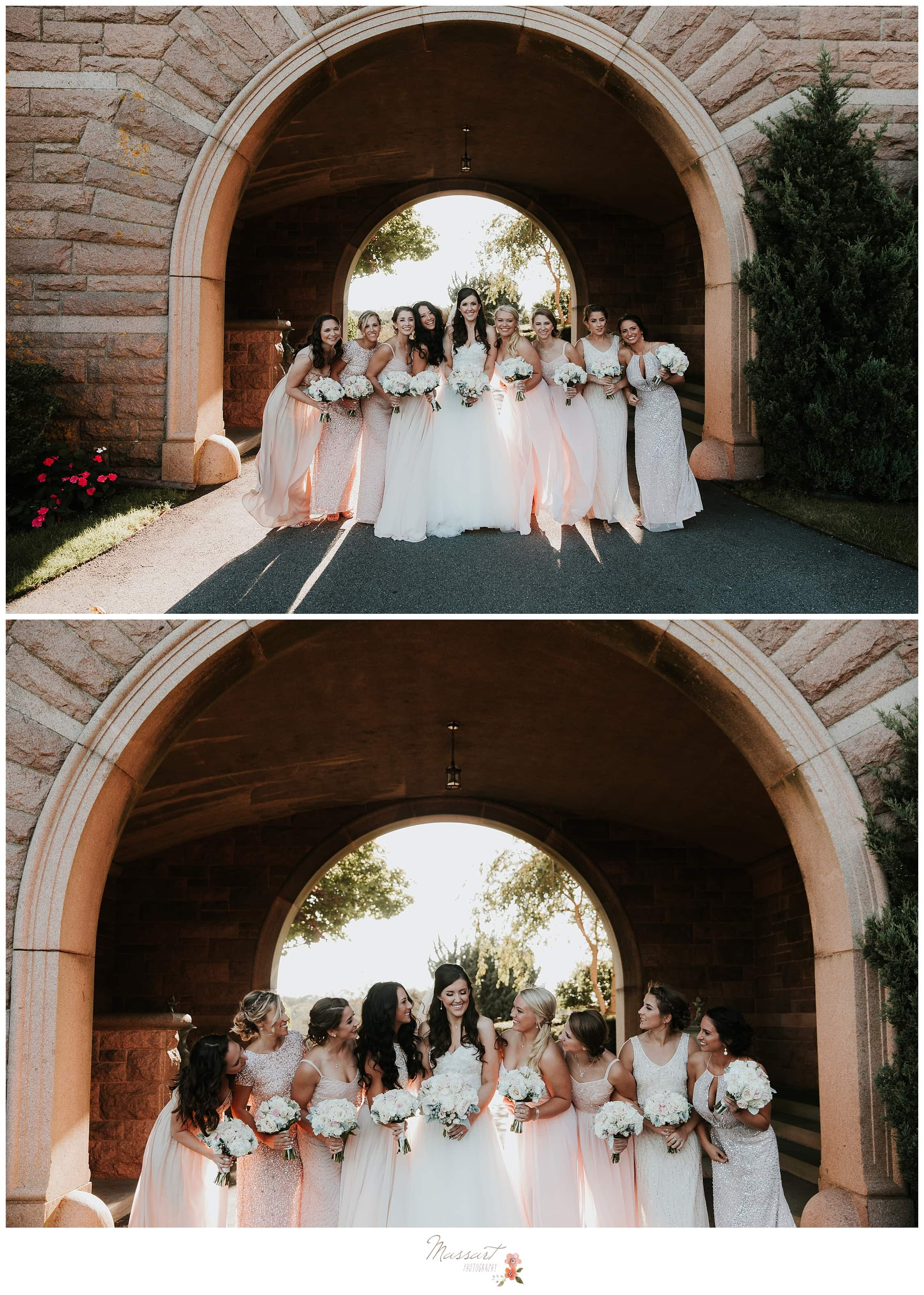 Bride and bridesmaids under the arch at Ocean Cliff Resort photographed by Massart Photography Rhode Island