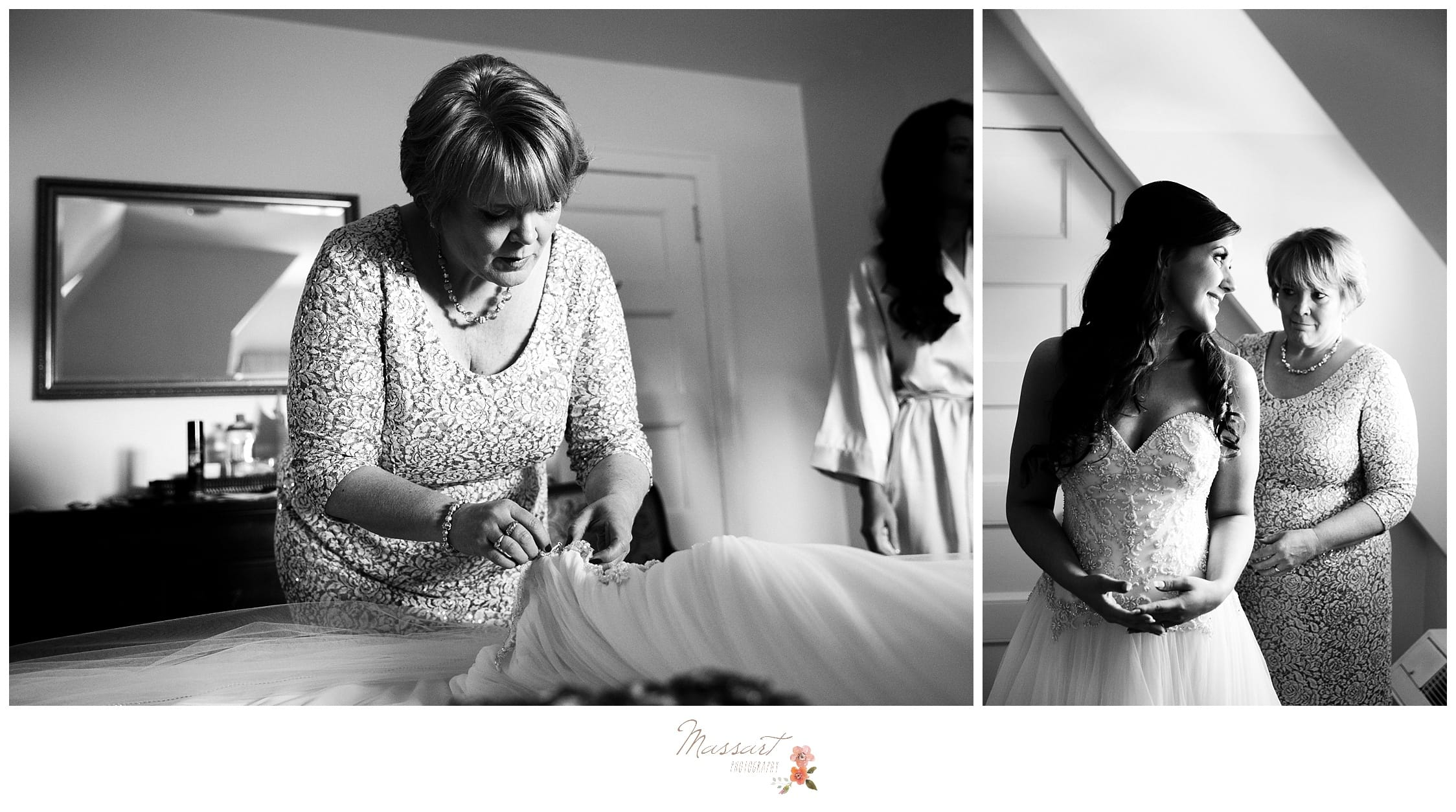 Bride's mother helps the bride get her wedding dress on photographed by Massart Photography RI