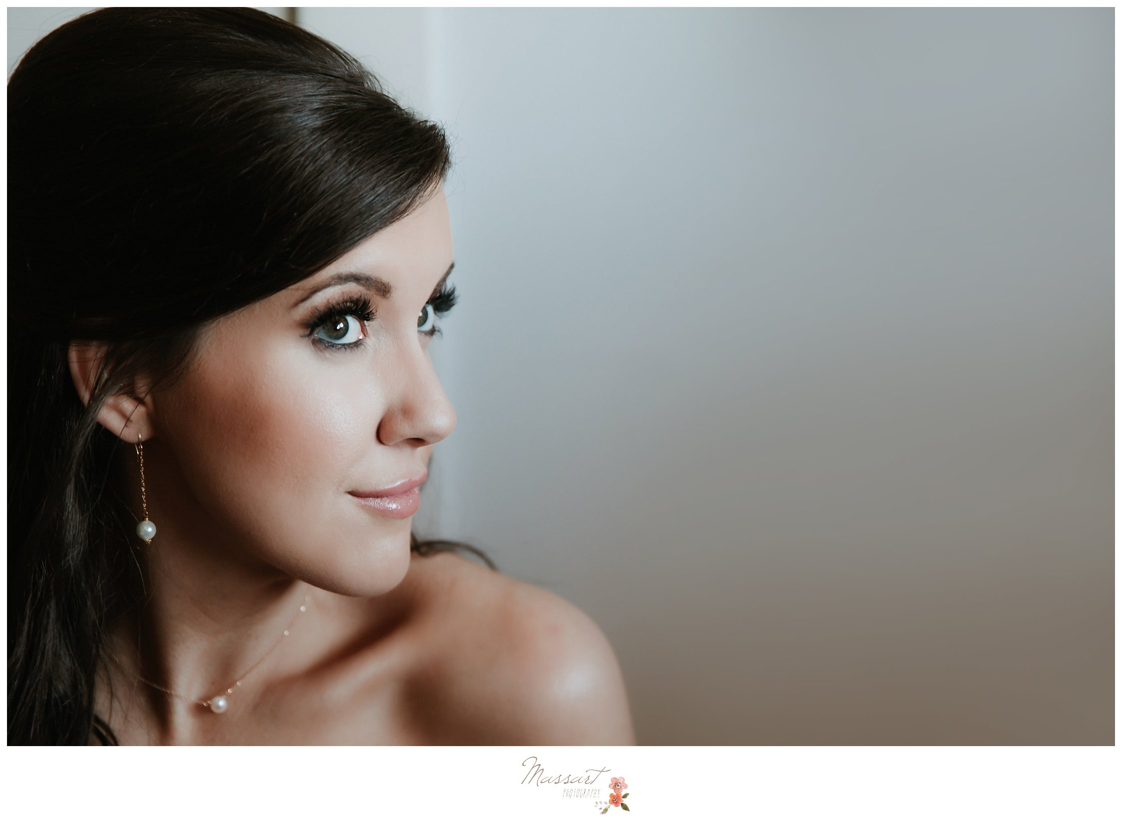 Bride shows her custom made jewelry for her wedding day photographed by Massart Photography Rhode Island