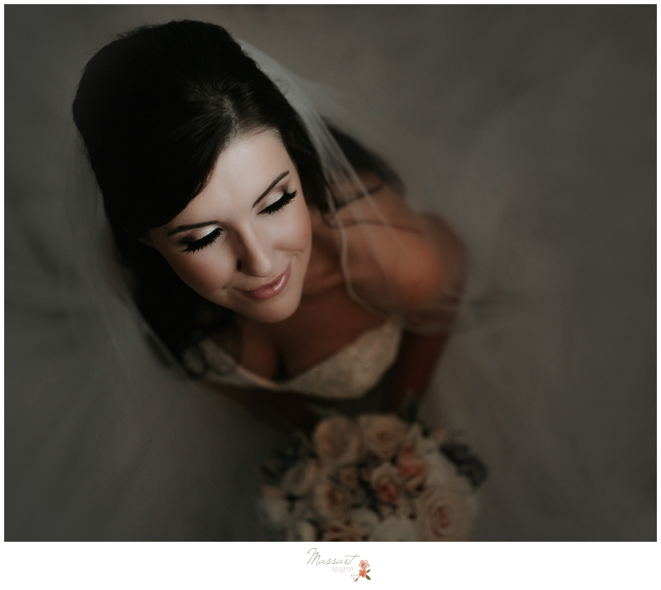 Bride sits amongst her long veil photographed by Massart Photography RI