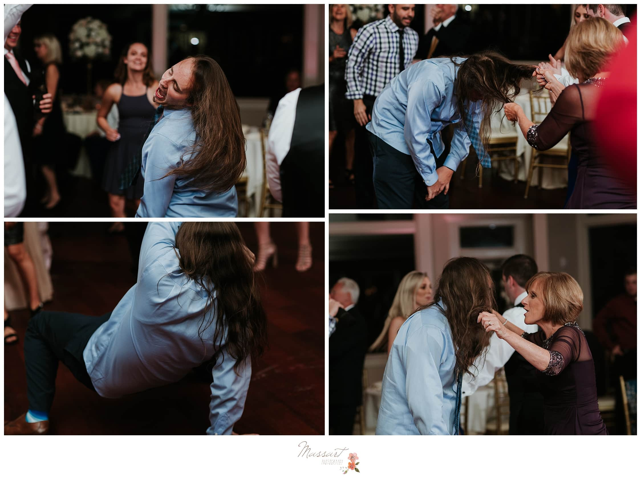 One wedding guest break dances at the reception photographed by Massart Photography RI